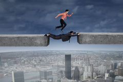 Businessman runs above his partner Stock Photography