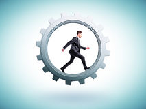 Businessman runs in gear Stock Photography