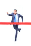 Businessman runs to goal Stock Images