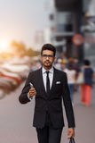 Businessman at rush hour walking in the street, in the style of motion blur. Businessman at rush hour walking in the street, in the style of motion blur Royalty Free Stock Image