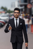 Businessman at rush hour walking in the street Royalty Free Stock Images