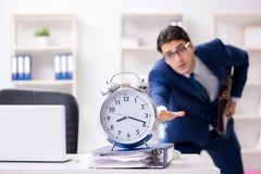 The businessman in rush trying to meet deadline. Businessman in rush trying to meet deadline Stock Photos