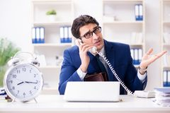 The businessman in rush trying to meet deadline. Businessman in rush trying to meet deadline Royalty Free Stock Images