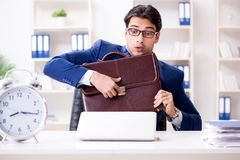 The businessman in rush trying to meet deadline. Businessman in rush trying to meet deadline Stock Photography