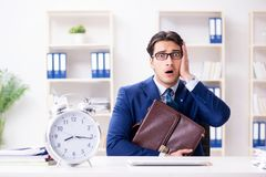 The businessman in rush trying to meet deadline. Businessman in rush trying to meet deadline Royalty Free Stock Photos