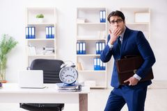 The businessman in rush trying to meet deadline. Businessman in rush trying to meet deadline Royalty Free Stock Photo