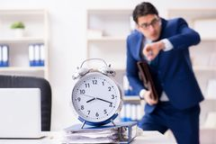 The businessman in rush trying to meet deadline. Businessman in rush trying to meet deadline Stock Images