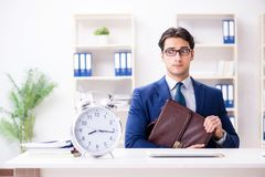The businessman in rush trying to meet deadline. Businessman in rush trying to meet deadline Royalty Free Stock Photography