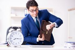 The businessman in rush trying to meet deadline. Businessman in rush trying to meet deadline Stock Photo