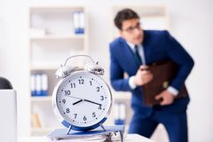 The businessman in rush trying to meet deadline. Businessman in rush trying to meet deadline Stock Image