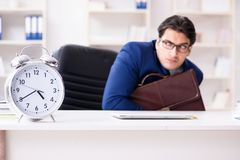The businessman in rush trying to meet deadline. Businessman in rush trying to meet deadline Royalty Free Stock Image