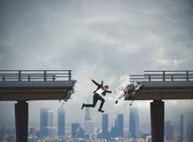 Businessman rushes down. Businessman falls by jumping a broken bridge. crisis concept Royalty Free Stock Photos
