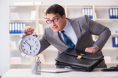 The businessman rushing in the office Stock Image