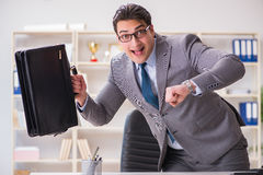 The businessman rushing in the office Royalty Free Stock Image