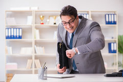 The businessman rushing in the office Royalty Free Stock Images