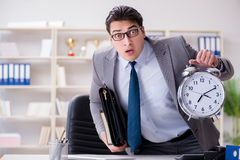 The businessman rushing in the office Royalty Free Stock Photos