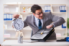 The businessman rushing in the office Stock Photos