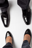 Businessman's and businesswoman's legs Royalty Free Stock Images