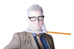 Businessman's Face Covered With Butterfly Net Royalty Free Stock Images