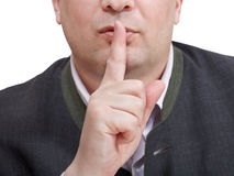 Businessman's finger near lips - silencesign Royalty Free Stock Photography