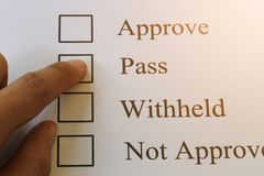 Businessman's fingers pointing at the check box and have pass te. Xt for design in presentation your work Stock Image