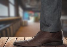 Businessman's foot and shoe on wood. Digital composite of Businessman's foot and shoe on wood Stock Photo
