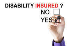 Businessman`s hand is approving disability insured Stock Photography