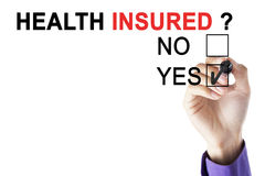 Businessman`s hand approving health insured Stock Photo