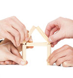 Businessman's hand building house by wooden block Stock Image