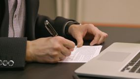 Businessman`s Hand Filling Contract Form With Pen stock video footage