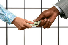 Businessman's hand gives woman dollars. Royalty Free Stock Image