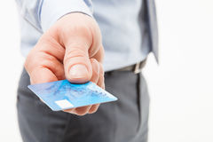 Businessman's hand giving credit card Stock Photography