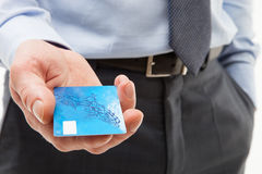 Businessman's hand giving credit card royalty free stock image