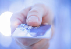 Businessman's hand giving credit card to you Royalty Free Stock Photo