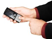 Businessman's hand holding a cell phone Royalty Free Stock Image