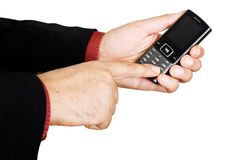 Businessman's hand holding a cell phone Royalty Free Stock Photo