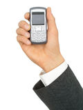 Businessman's Hand Holding a Cell Phone Stock Photography