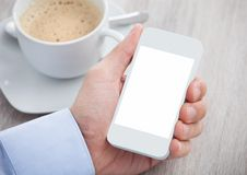 Businessman's hand holding cellphone with blank screen Stock Photography