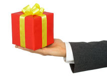 Businessman's Hand Holding Gift. On White Stock Image