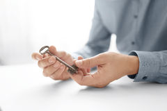 Businessman's hand holding key. Key Business Solutions. Business concept of success. Stock Photos