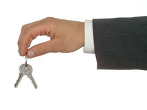Businessman's Hand Holding Keys Royalty Free Stock Photos