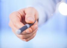 Businessman's hand holding a pen Stock Images
