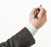 Businessman's hand holding a pen Stock Photos