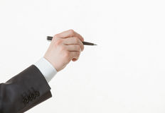 Businessman's hand holding a pen Royalty Free Stock Photo