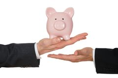 Businessman's hand holding piggybank Royalty Free Stock Images