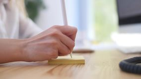A businessman`s hand holds a pen in the office. Keyboard, office Royalty Free Stock Photography
