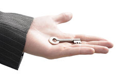 Businessman's hand with a key Stock Images