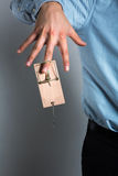 Businessman's hand in the mousetrap Stock Images