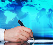 Businessmans hand with a pen Royalty Free Stock Image