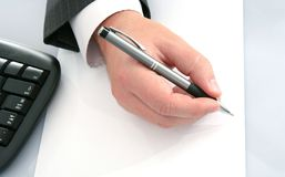 Businessman;s hand  with pen Stock Image